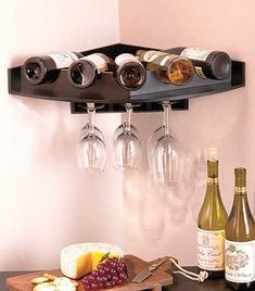 Corner Wall Wine and Glass Rack makes use of unused space to hold your wine and stemware. The wooden piece holds 5 bottles of wine on top and up to 9 glasses up