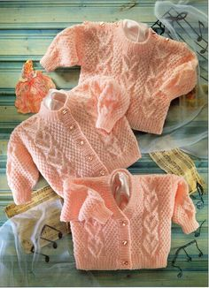 Offering a vintage PDF knitting pattern to make sweet cabled hearts sweaters - cardigan style and pullover button shoulder design. DK Light worsted yarn, Pattern Four sizes, to fit chests 22 inch cm) - Birth to 2 years old Requires knitting needles sizes Baby Cardigan Knitting Pattern Free, Knitted Baby Cardigan, Knit Baby Sweaters, Baby Knitting Patterns, Sweater Cardigan, Cable Cardigan, Pullover Sweaters, Baby Clothes Patterns, Baby Girl Patterns