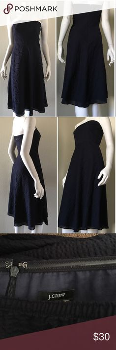 "J Crew Navy Blue Tube Textured Dress Pre-owned in great condition textured dress. Fully lined. Back zip closure. There are wires/plastic strips on  both sides to give extra support up top. Approx. measurements (measured across and not doubled) Pit to pit 15"" plus a bit of stretch because of the elastic; Waist 14""; Length from armpit seam to hem 37"".  100% cotton. No flaws detected. J. Crew Dresses Midi"