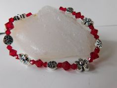 Check out this item in my Etsy shop https://www.etsy.com/listing/480456241/red-beaded-bracelet-handmade-bracelet