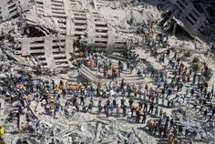 NEW YORK - SEPTEMBER 13, 2001: Rescue workers sift through the wreckage of the World Trade Center, two days after two hijacked airplanes slammed into the twin towers, levelling them in an alleged terrorist attack, September 13, 2001 in New York City. This September 11 marks ten years since members of Al Qaeda hijacked four planes, attacking the World Trade Center and the Pentagon and crashing one in Shanksville, Pennsylvania, killing nearly 3,000 people in all. The effects continue to…