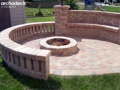 Built-in fire pit design with stone seat walls