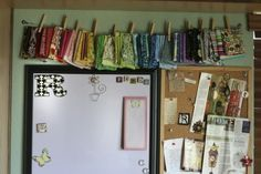 I like the way the small bits of fabric are clothes pinned onto the clothes line.  Good way to display fabric.