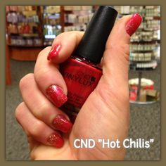 "CND Vinylux ""Hot Chilis"" with a little glitter added. City Looks Salon and Spa, Cedar Rapids."