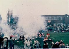 Photograph of Alpha Tau Omega cannon explosion at the 1960 SU vs. Penn State game. A gift from a 1922 alumnus, the cannon was fired for every SU touchdown & every winning home game. At this game, the ATO brothers fired a shot, but a spark fell into a suitcase full of gunpowder behind the cannon. Click for full story! Photograph by Gordon Allen, '61, G'82. Courtesy Syracuse University Archives.