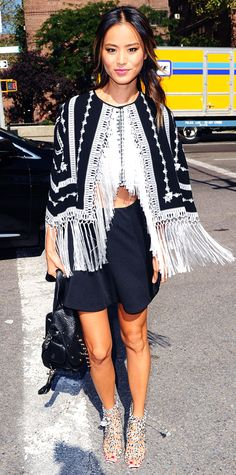 Jamie Chung gave her NYFW front row look a playful spin with a black-and-white embroidered fringe top, a flirty flared mini skirt, a black Rebecca Minkoff backpack slung, and printed lace-up Sophia Webster heels. #InStyle