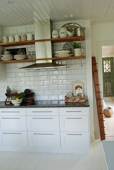 Modern Hood in Cottage Kitchen... love the shelfs