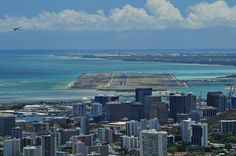 """Honolulu International Airport's principal runway, popularly called the """"reef runway"""" was the world's first major runway built entirely offshore on an underwater fringing coral reef."""