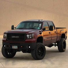Sweet Lifted Maroon GMC                                                                                                                                                                                 More