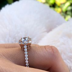 This rose gold diamond halo engagement ring features a halo top, set with diamonds framing the princess cut moissanite center. The shank is adorned with diamonds cascading down the narrow shank on the sides of the sightly squared shank. Princess Cut Engagement Rings, Halo Diamond Engagement Ring, Princess Cut Diamonds, Prong Set, Moissanite, Shank, Colored Diamonds, Rocks, Vogue