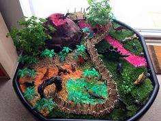 Jurassic Park, Dinosaur themed, small world tuff tray Dinosaur Small World, Dinosaur Land, Dinosaur Garden, Small World Play, Dinosaur Projects, Dinosaur Activities, Tuff Spot, Nursery Activities, Tuff Tray
