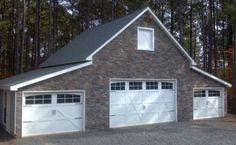 What doors with windows and black straps. Model 7100 by Wayne Dalton. Garage Door Photo Gallery - Residential