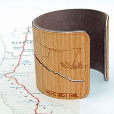 "Pacific Crest Trail Bracelet  - Brushed aluminum cuff - Cherry wood - Lined with 100% recycled ultrasuede - Width 2"" - Adjustable to fit any size wrist  #WHYIHIKE #MINTERANDRICHTER"