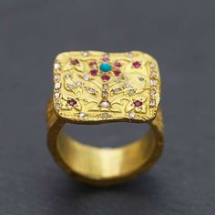 Magnificent original gold ring crafted in 18k & carving in the matter, set with diamonds, turquoise, rubies, pearls, large ring engraved.  Art artisan creation Esther Assouline, made in Paris   € 5580.00