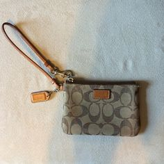 "Authentic Signature Coach Wristlet Very lightly worn brown signature coach wristlet. Genuine coach item. Approx 6"" x 4"" in size. Coach Bags Clutches & Wristlets"