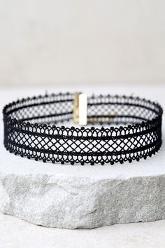 """Our greatest find of the season is the Catch Your Attention Black Mesh Choker Necklace! Dainty crocheted mesh is formed to this sexy (and versatile!) black mesh choker. Necklace measures 11.75"""" long with a 4"""" extender chain,"""