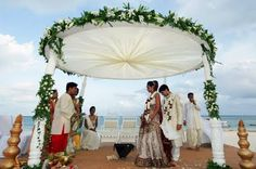 Indian wedding, kenyan beach.  I really like this arch.