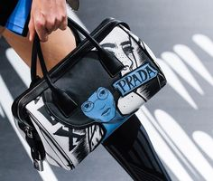bf90c226a66f Prada s Spring 2018 Runway Bags Included Lots of Nylon and a Cast of Female  Comic Heroes Searching for Prada handbags on sale or Prada handbag  authentic ...