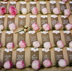 Escort cards with a dash of pink garden roses.  Photo by A Bryan Photo.