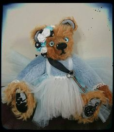 Check out this item in my Etsy shop https://www.etsy.com/uk/listing/582652398/alice-mohair-jointed-sitting-traditional