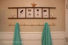 Turn an old ladder sideways and use to frame inexpensive prints and related memorabilia... like these starfish and shell prints.