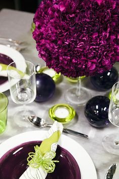 An elevated pomander of densely-packed carnations looks modern when paired with chartreuse accents.