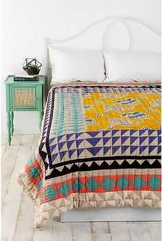Top off the bohemian look by layering one of these Magical Thinking Kantha Patchwork Quilts...
