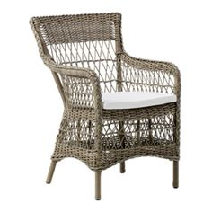 The Marie Arm Chair by Sika in Antique with White Cushion has a timeless design in polyrattan fibers on aluminum frames for indoor or outdoor use.