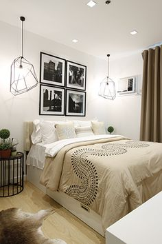 The master bedroom is nothing short of inviting and relaxing. The 12'' mattress is made more comfortable with white and cream sheets while the framed black-and-white photographs add depth and contrast to the the space.