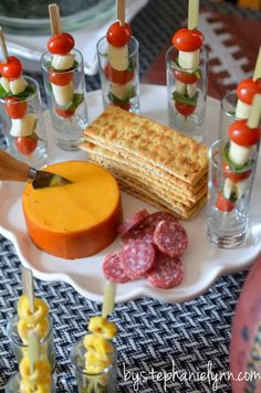 Antipasto on bamboo knot picks served in tall shot glasses Glacier ridge farms smoked gouda and roasted garlic cheese rounds along with sliced busseto mini dry salami World Market Sundried Tomato and Basil Flatbread  - Under the Table and Dreaming >> #WorldMarket
