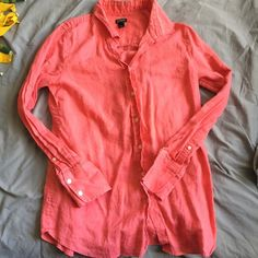 Jcrew long sleeve button up Coral color, worn a few times in great condition. Just a little wrinkly. J. Crew Tops Button Down Shirts