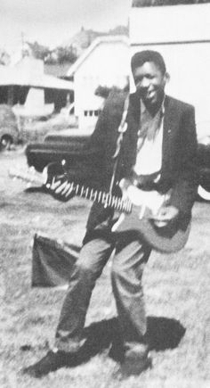 Jimi Hendrix with his first electric guitar in Seattle, 1957.