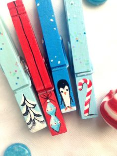 PAINTED CHRISTMAS CLOTHESPINS  red and blue wooden glitter snow covered trees candy canes vintage ornament penguin magnets by SugarAndPaint on Etsy