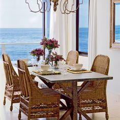 Comfort Space  California-based designer Tim Clarke loves to mix several styles in a room for an interesting look. Here, a delicate chandelier blends with coastal wicker chairs and a rustic farm table.