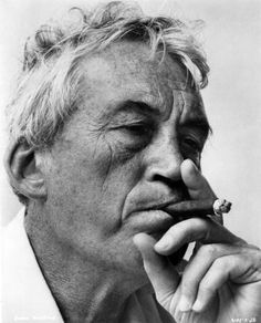 "Director John Huston during filming of his ""The Night of the Iguana""."