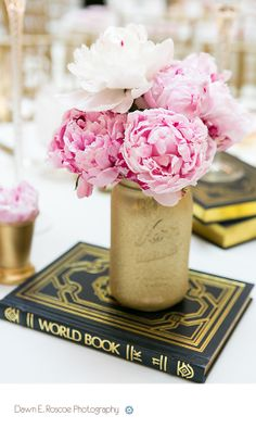 Peonies, gold spray painted mason jars and old world books tablescape.