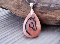 A lovely gift for the horse lover, this Oregon Picture jasper stone pendant is engraved with a simple but elegant abstract horse design. The image was deep etched (sandblasted) on the face of this lovely stone pendant and filled with black metallic paint. This pendant is smaller than most of my other pendants (25x38mm) and is perfect for a teen or person that prefers a more dainty pendant. The lovely bail is sterling silver (0.925).    *** PLEASE SPECIFY length and type of cord desired at…