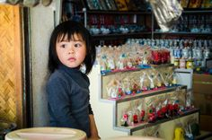 A young girl sits in her families shop - Thailand - Travel Photography on Etsy, $28.00