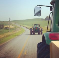 This big-wheeled wide load ain't goin' any faster,  So just smile and wave and tip your hat     to the man up on the tractor