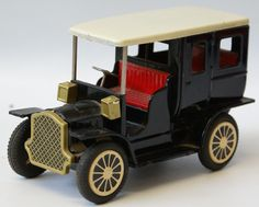 """Vintage Tin Friction Cadillac Toy Car, made in Japan. Believe this one is by Cragstan. Black body with cream roof. This cute little car measures 6"""" long. Some slight playwear. Nice working condition."""