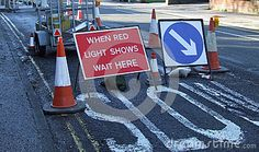 Road Works With When Red Light Shows Wait Here Sig - Download From Over 48 Million High Quality Stock Photos, Images, Vectors. Sign up for FREE today. Image: 36663202