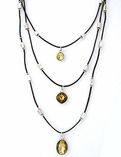 """Long Triple Crystal Pendant Necklace on Leather Sweet Lola. $40.00. Longest strand is 40"""", hortest strand is 25"""". Three crystal pendants. Very long triple pendant necklace. 2 1/2"""" extender & lobster clasp.. Dark brown leather strands with industrial chic silver beads"""
