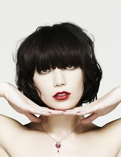 Daisy Lowes messy bob with long bangs...
