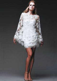 Robe FLORE, en satin stretch et galon de dentelle brodée, cape HÉLIUM en dentelle brodée. Dress FLORE, in stretch satin with embroidered lace braid, cape HÉLIUM in embroidered lace.