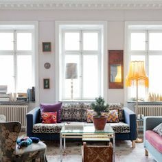 Featured in Marie Claire Maison. Karlanda sofa from IKEA with a Piper Twill Dark Denim Blue cover mixed with a New Baroque Jet Black cover - both from Bemz. Fuchsia and Orange Kvarter Artist Series cushion covers from Bemz.
