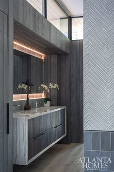 A mix of natural elements—wood-like tile floors and custom vanities fabricated by George Peker's Addhouse topped with Walker Zanger's White Macaubus—shine alongside man-made materials in earthy tones, such as the chevron tile wrapping the fireplace and planks of porcelain tiles surrounding the sunken bath and in the shower. Organic Interiors, Walker Zanger Tile, Modern Bathroom, Modern Design, Custom Vanity, Chevron Tile, Wood Like Tile, Sunken Bath, Cool Stuff