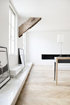 carrerra marble and herringbone wood floors are friends