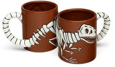 This clever T. Rex mug features a T. Rex tail bone handle.