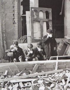 Children, made homeless during The Blitz, have a cuppa. WWII
