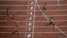 A picture taken with a robotic camera shows Jamaica's Usain Bolt crossing the finish line to win the men's 200m final